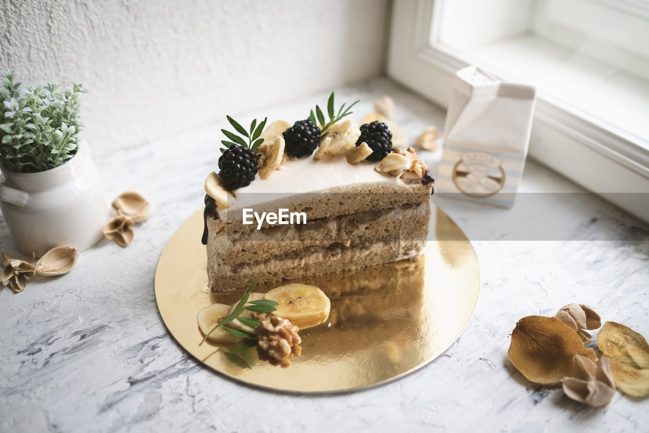 food, food and drink, table, freshness, still life, indoors, indulgence, ready-to-eat, no people, sweet food, plate, serving size, close-up, high angle view, dessert, sweet, temptation, focus on foreground, baked, kitchen utensil