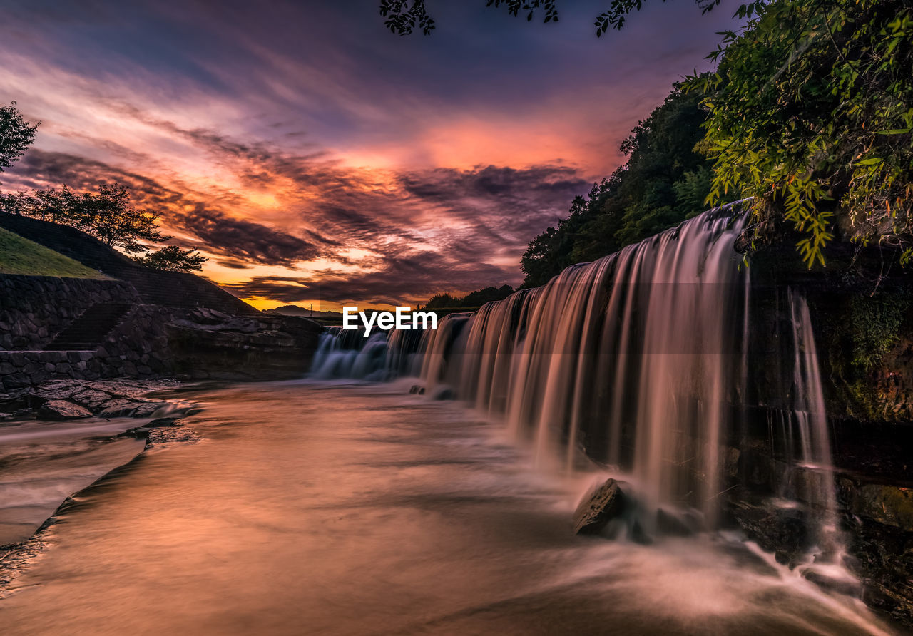 beauty in nature, scenics - nature, water, sunset, waterfall, long exposure, motion, sky, nature, flowing water, tree, tranquil scene, idyllic, non-urban scene, cloud - sky, no people, blurred motion, tranquility, land, flowing, power in nature