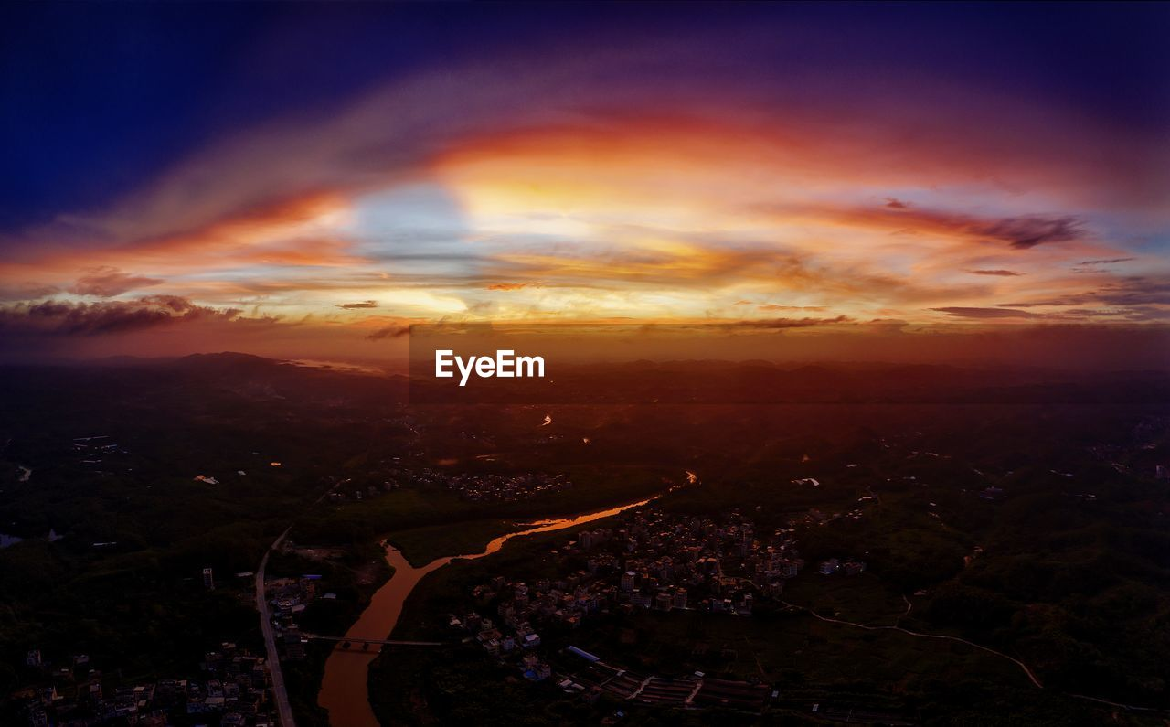 AERIAL VIEW OF CITYSCAPE DURING SUNSET