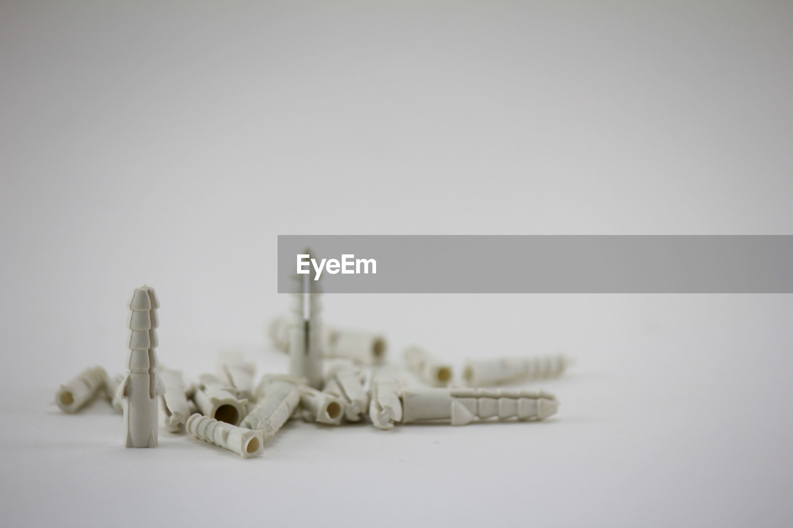 Close-up of hollow wall anchors over white background
