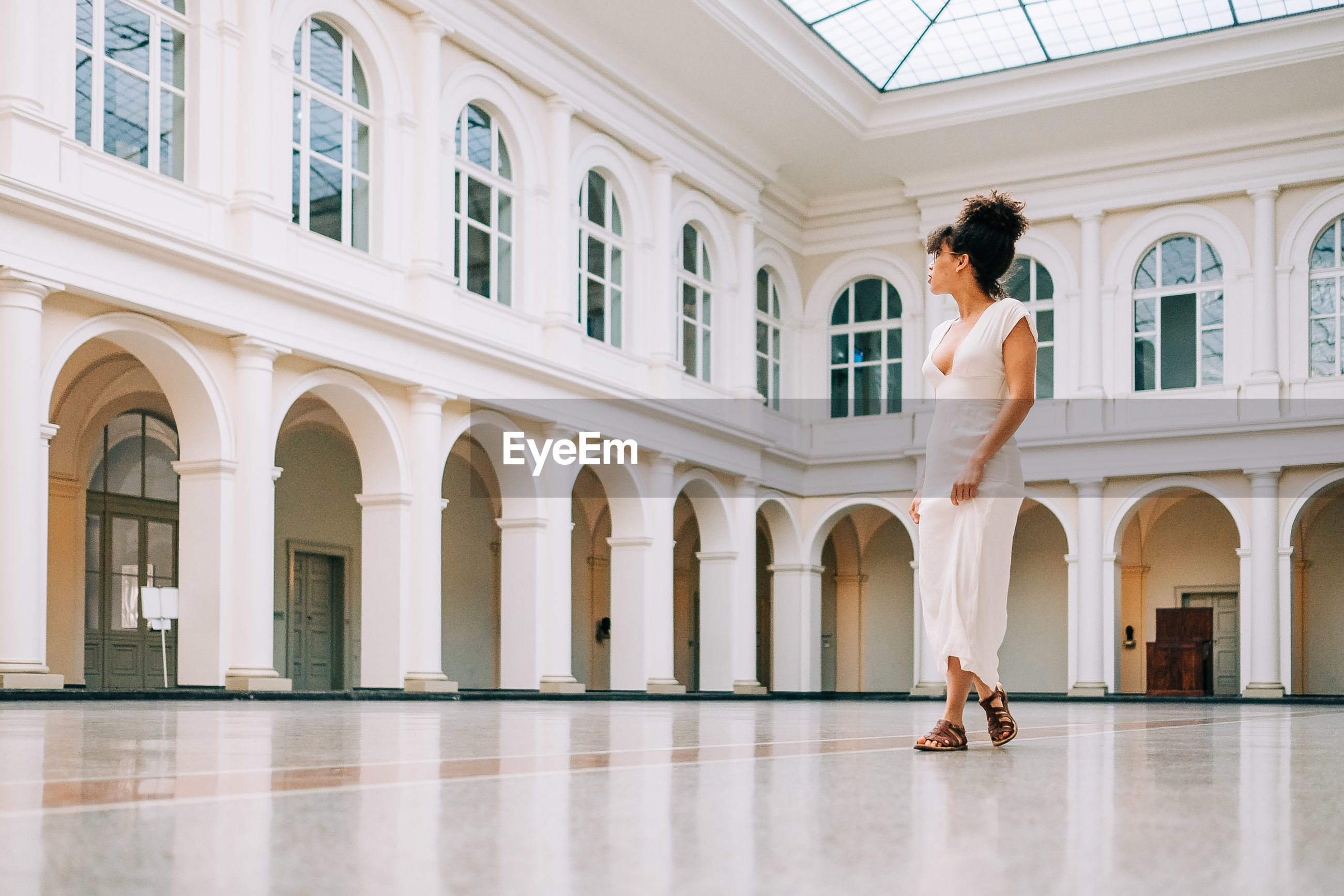 Fashionable woman standing on floor of building