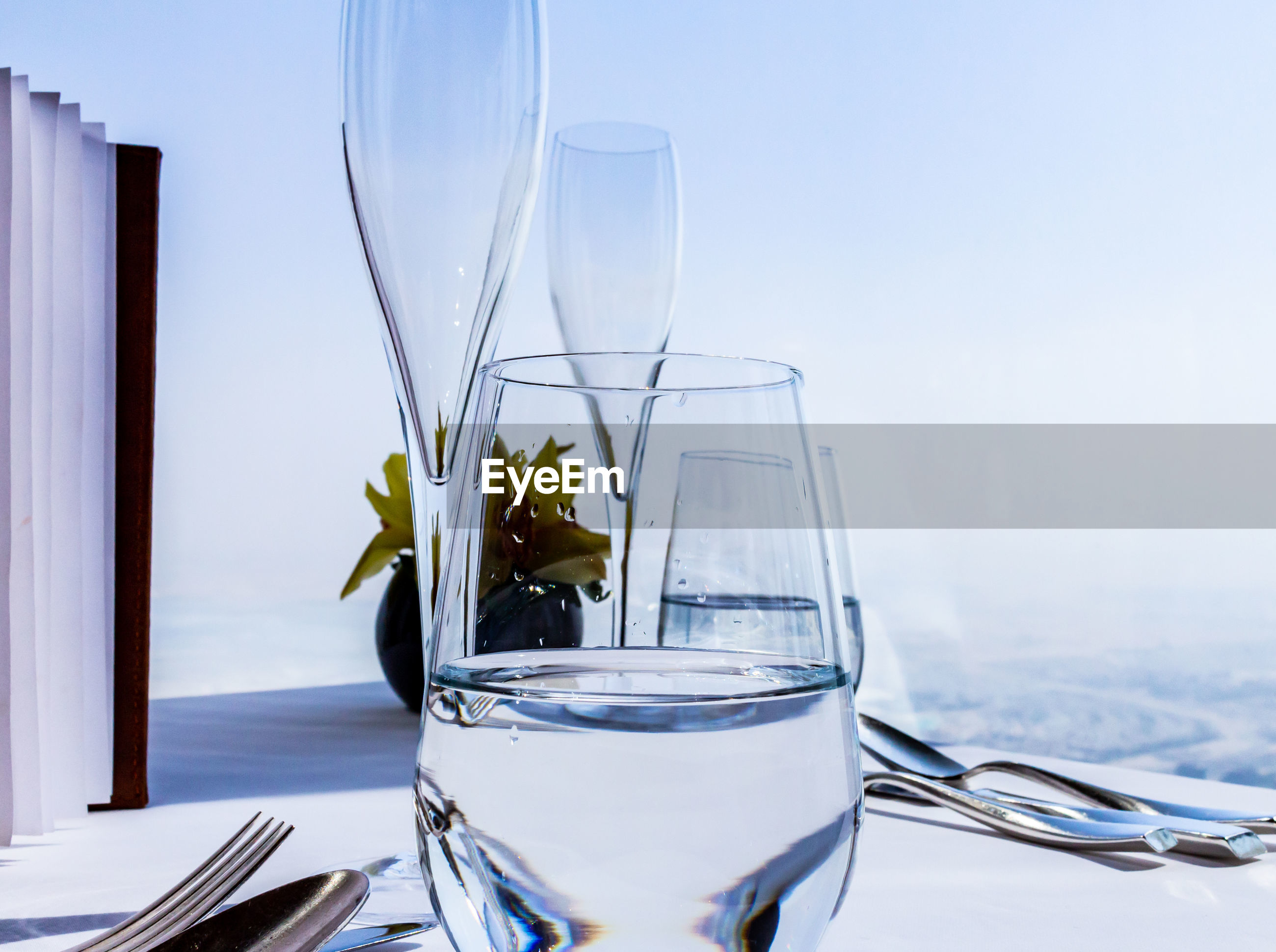 CLOSE-UP OF DRINK ON TABLE AGAINST GLASS