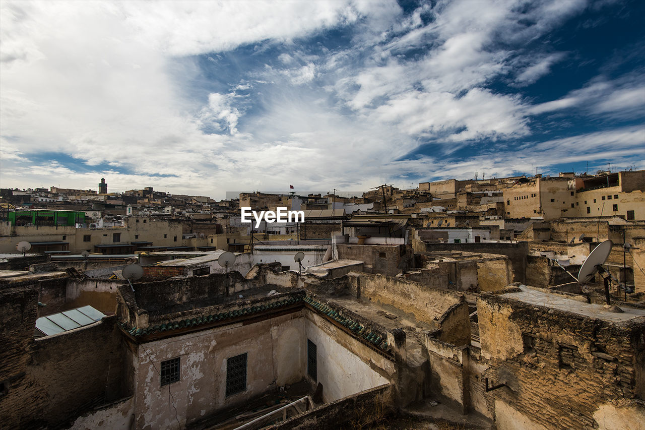 High Angle Shot Of Townscape Against Cloudy Sky
