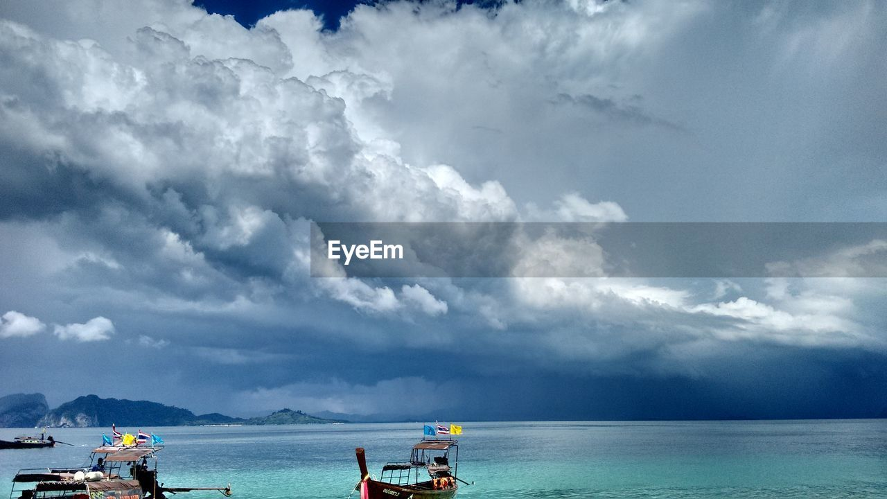 cloud - sky, sky, water, sea, beauty in nature, scenics, nature, day, outdoors, horizon over water, tranquility, tranquil scene, nautical vessel, vacations, men, beach, real people, people