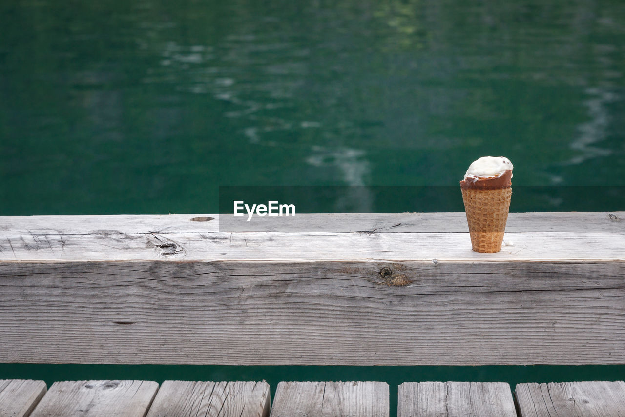 Ice Cream Cone On Pier By Lake