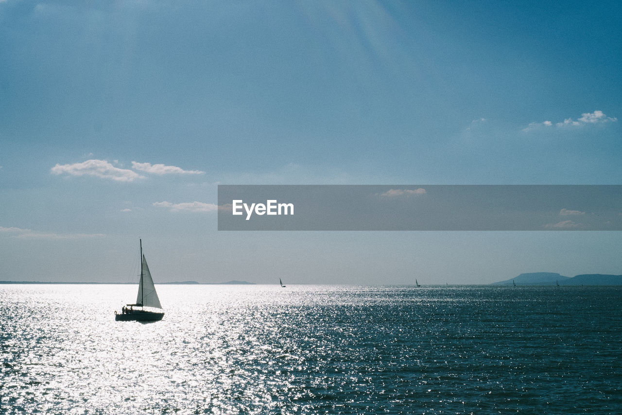 sea, nautical vessel, sailboat, water, sky, sailing, scenics - nature, mode of transportation, beauty in nature, transportation, horizon over water, horizon, waterfront, cloud - sky, tranquil scene, tranquility, nature, canvas, travel, no people, outdoors, yacht, yachting, luxury