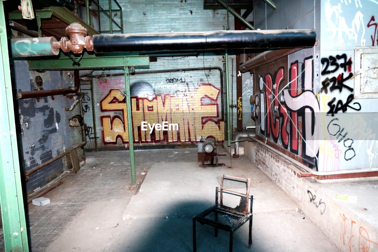 graffiti, architecture, built structure, absence, empty, indoors, abandoned, no people, day, city