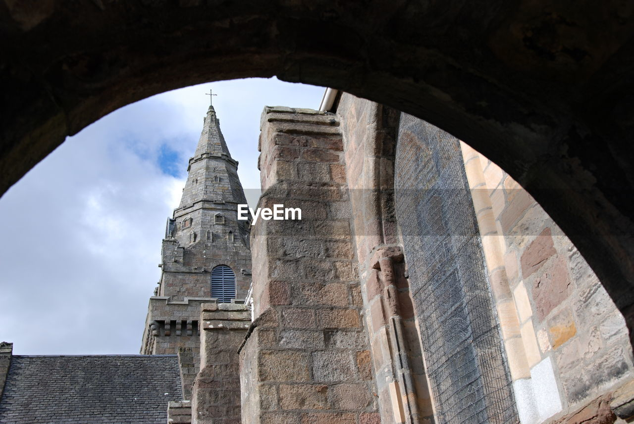 architecture, built structure, building exterior, building, history, the past, low angle view, sky, arch, travel destinations, day, tower, place of worship, religion, tourism, no people, spirituality, travel, belief, old, outdoors, ancient civilization, spire, ruined