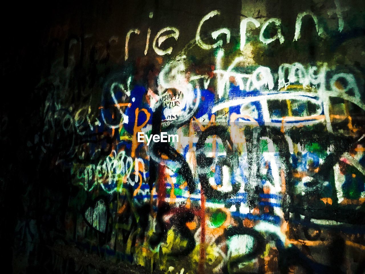 text, graffiti, illuminated, communication, no people, night, close-up, multi colored, architecture, outdoors