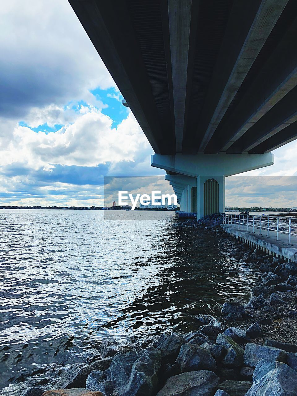 bridge - man made structure, connection, architecture, built structure, cloud - sky, sky, transportation, sea, below, water, day, underneath, bridge, no people, outdoors, horizon over water, nature, under, scenics, beauty in nature