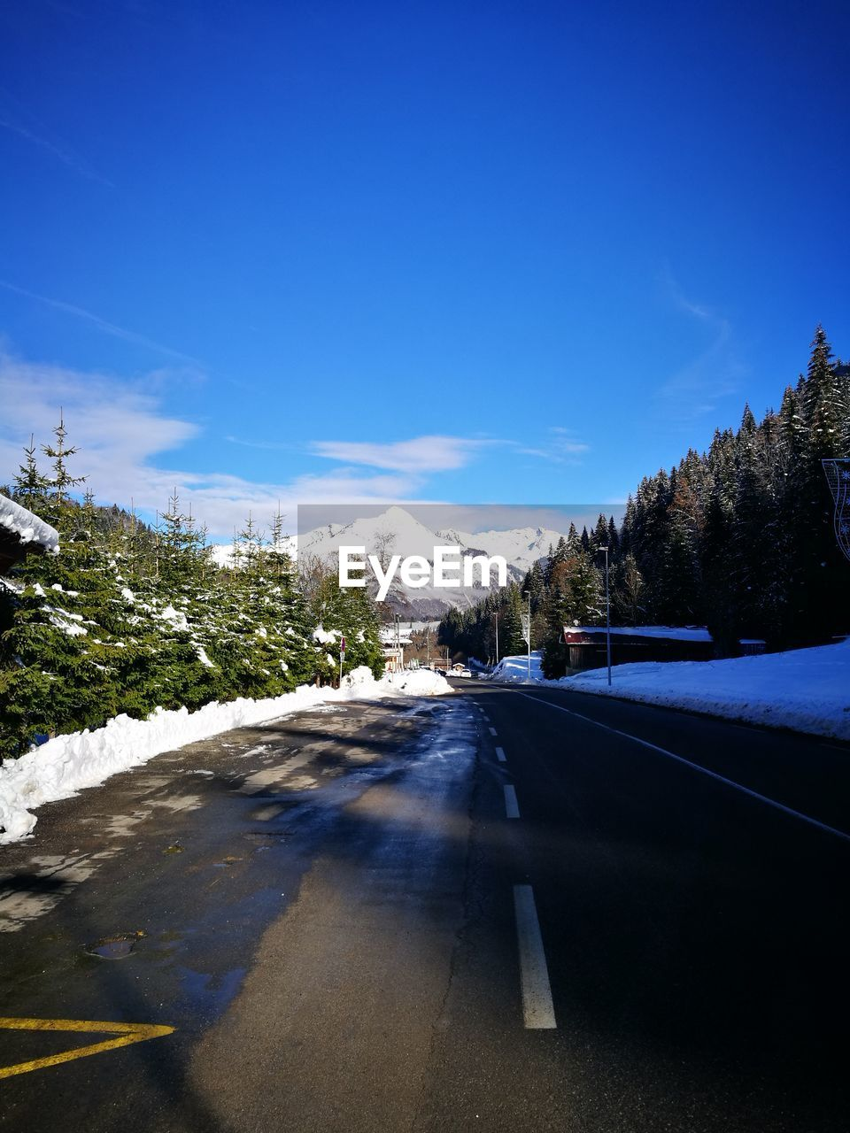 road, the way forward, transportation, winter, snow, nature, diminishing perspective, cold temperature, sky, tree, tranquil scene, scenics, mountain, car, day, no people, tranquility, landscape, beauty in nature, outdoors, blue, car point of view, clear sky