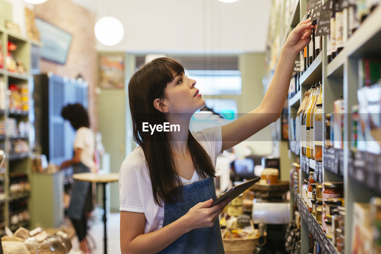 YOUNG WOMAN LOOKING AT STORE