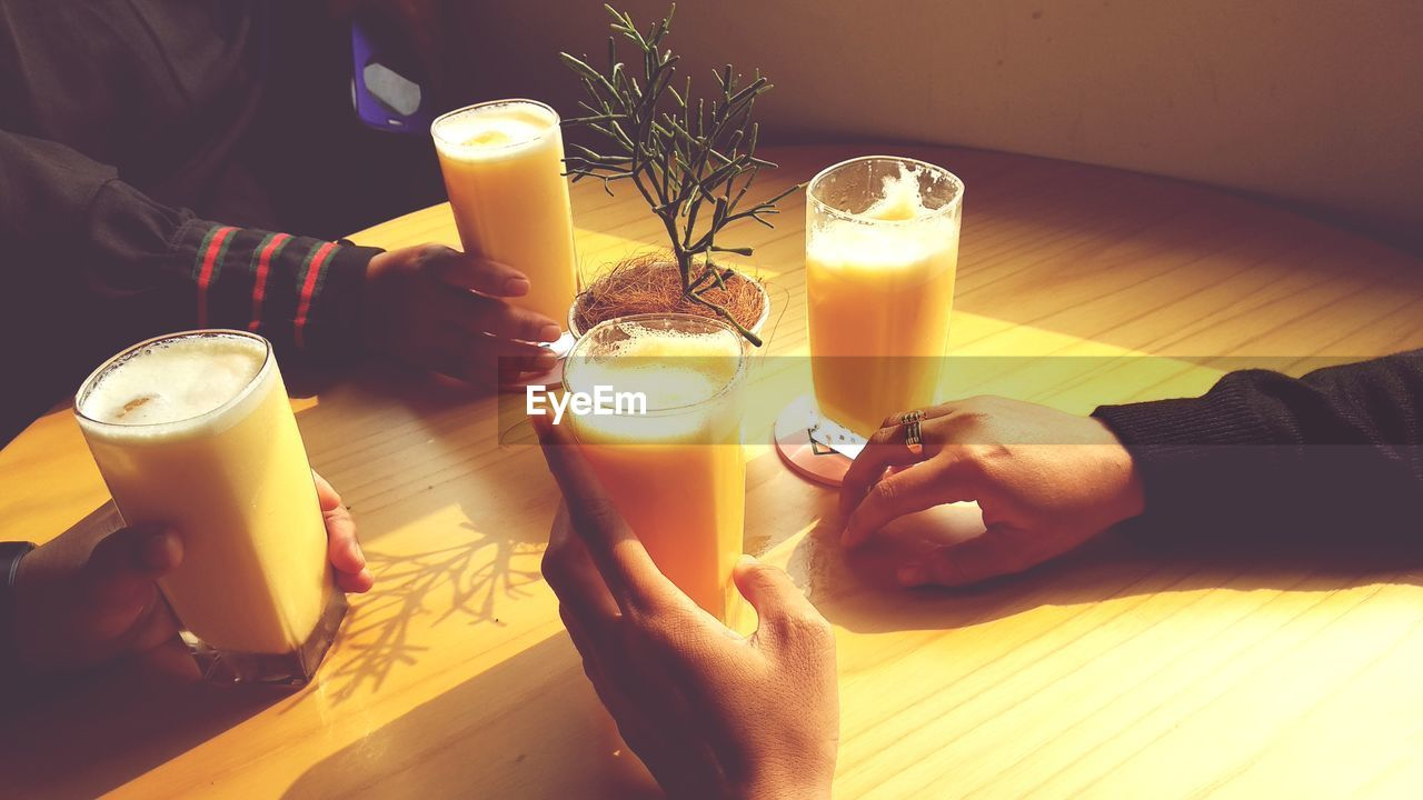 drink, human hand, food and drink, refreshment, hand, human body part, real people, table, glass, lifestyles, drinking glass, indoors, people, household equipment, holding, freshness, adult, leisure activity, women, straw