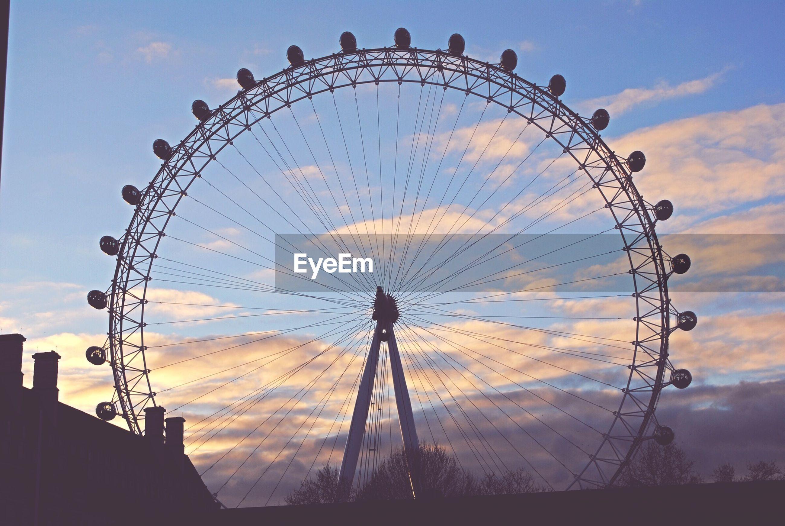 ferris wheel, amusement park, amusement park ride, arts culture and entertainment, sky, low angle view, cloud - sky, silhouette, built structure, cloud, sunset, architecture, cloudy, circle, big wheel, dusk, fairground ride, travel destinations, outdoors, fun