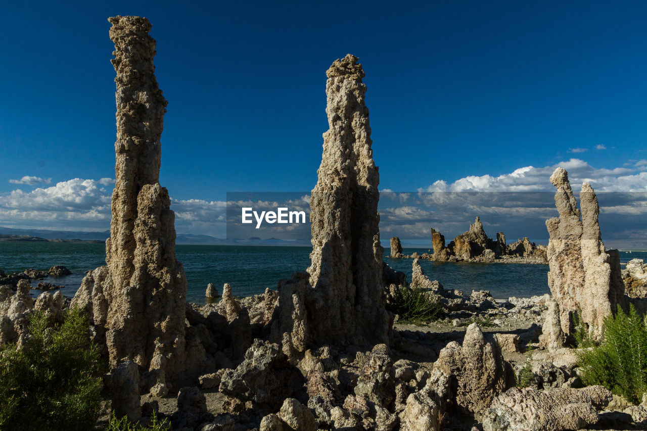 Scenic view of mono lake against blue sky