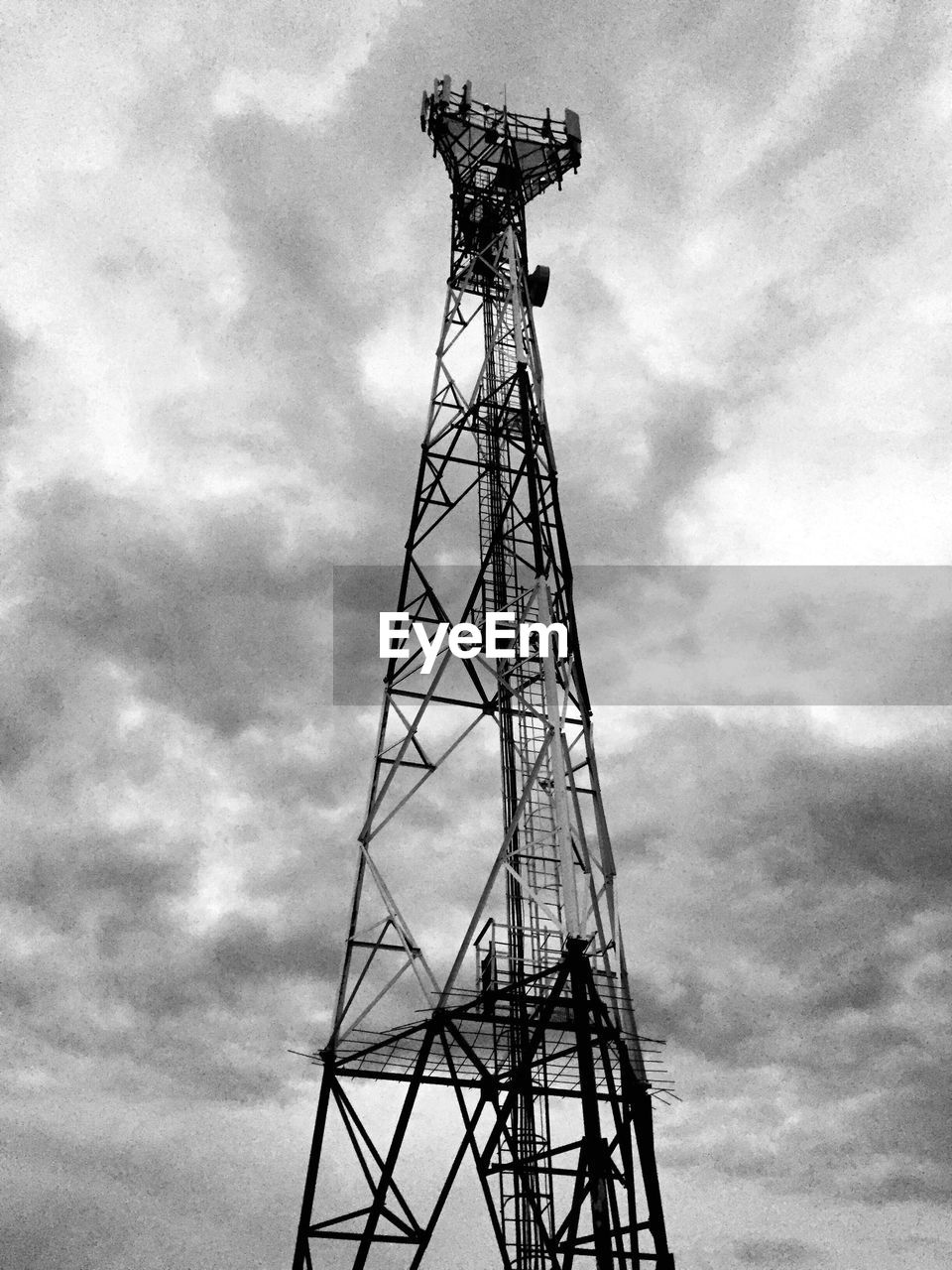 cloud - sky, low angle view, tower, sky, day, global communications, no people, outdoors, technology, architecture, nature