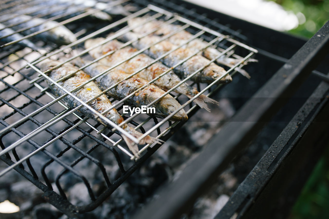 Close-Up Of Fishes On Barbecue Grill