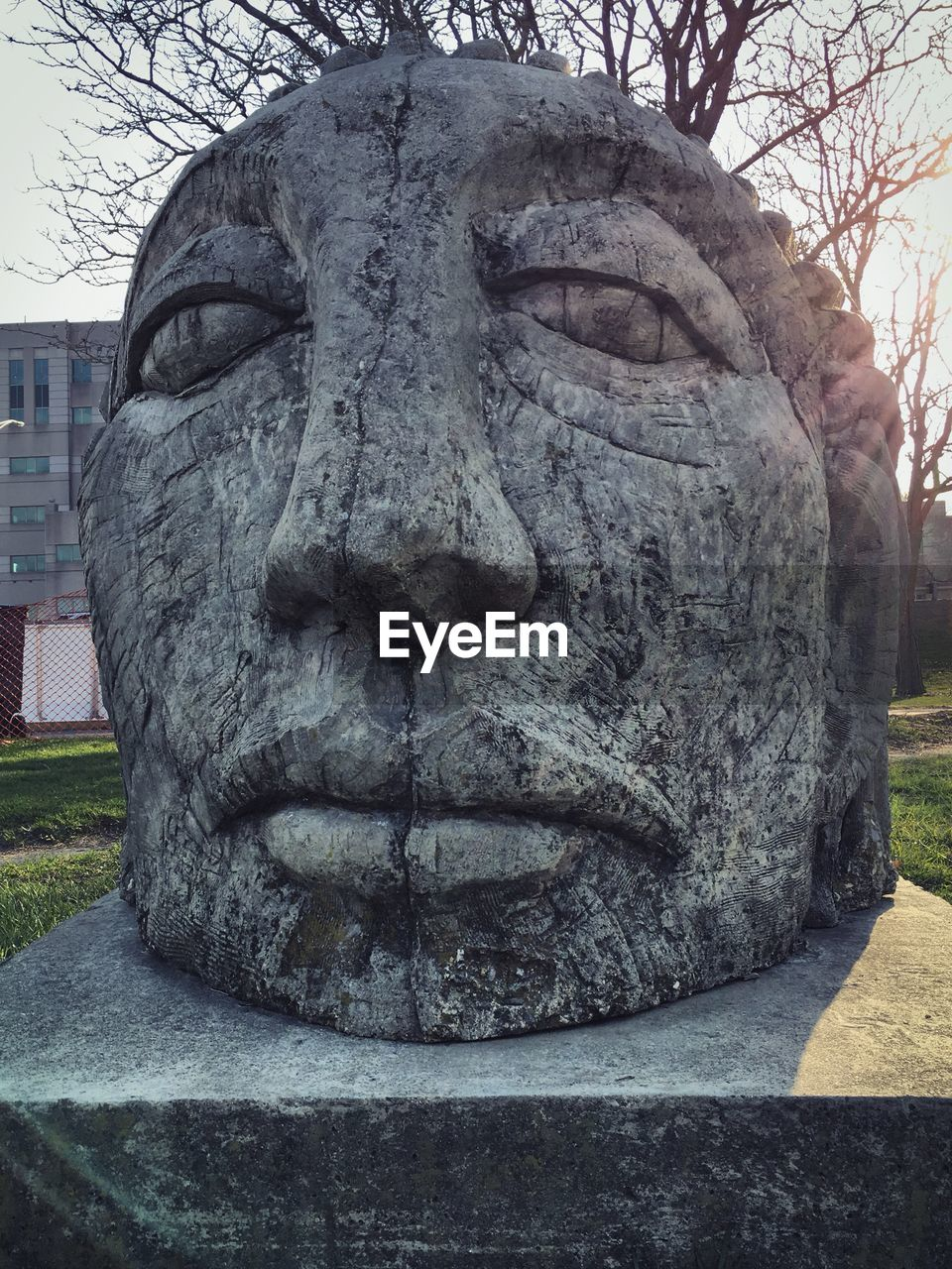 art and craft, sculpture, representation, creativity, craft, statue, architecture, human representation, day, no people, carving - craft product, close-up, park, face, male likeness, park - man made space, built structure, stone material, tree, carving