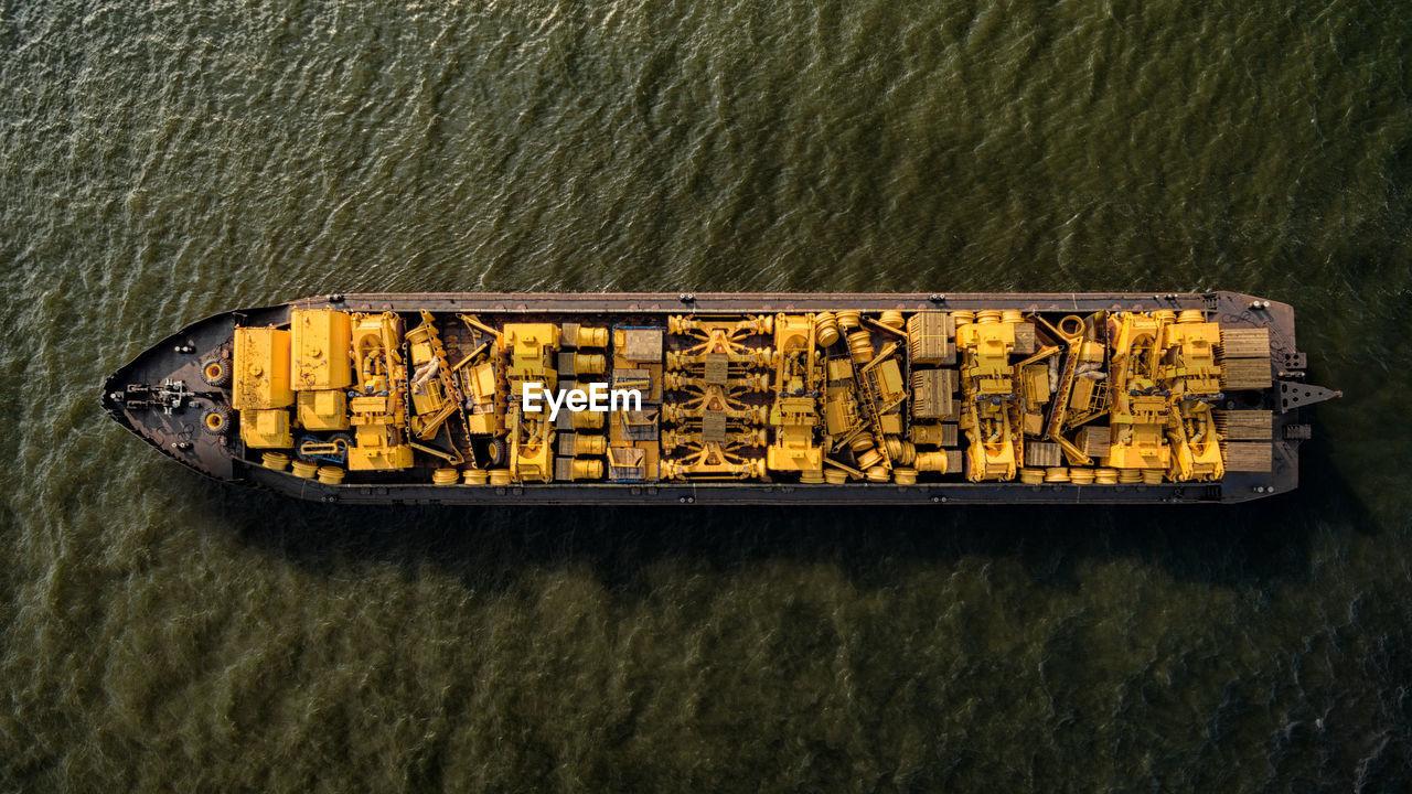 High Angle View Of Yellow Equipments On Ship