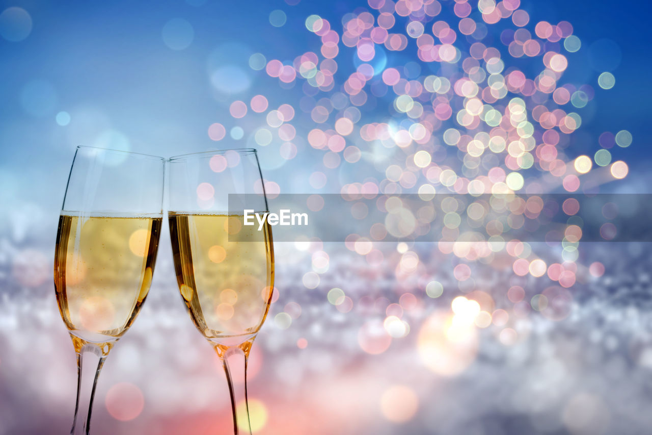 refreshment, drink, food and drink, glass, champagne, wine, alcohol, champagne flute, glass - material, illuminated, wineglass, household equipment, celebration, focus on foreground, transparent, no people, lens flare, freshness, drinking glass