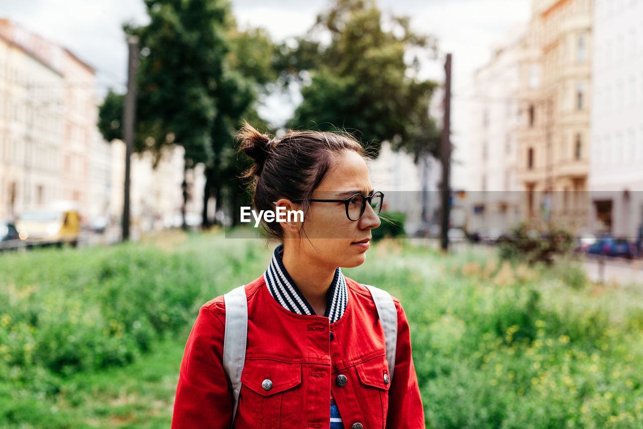 Young Woman With Eyeglasses Looking Away