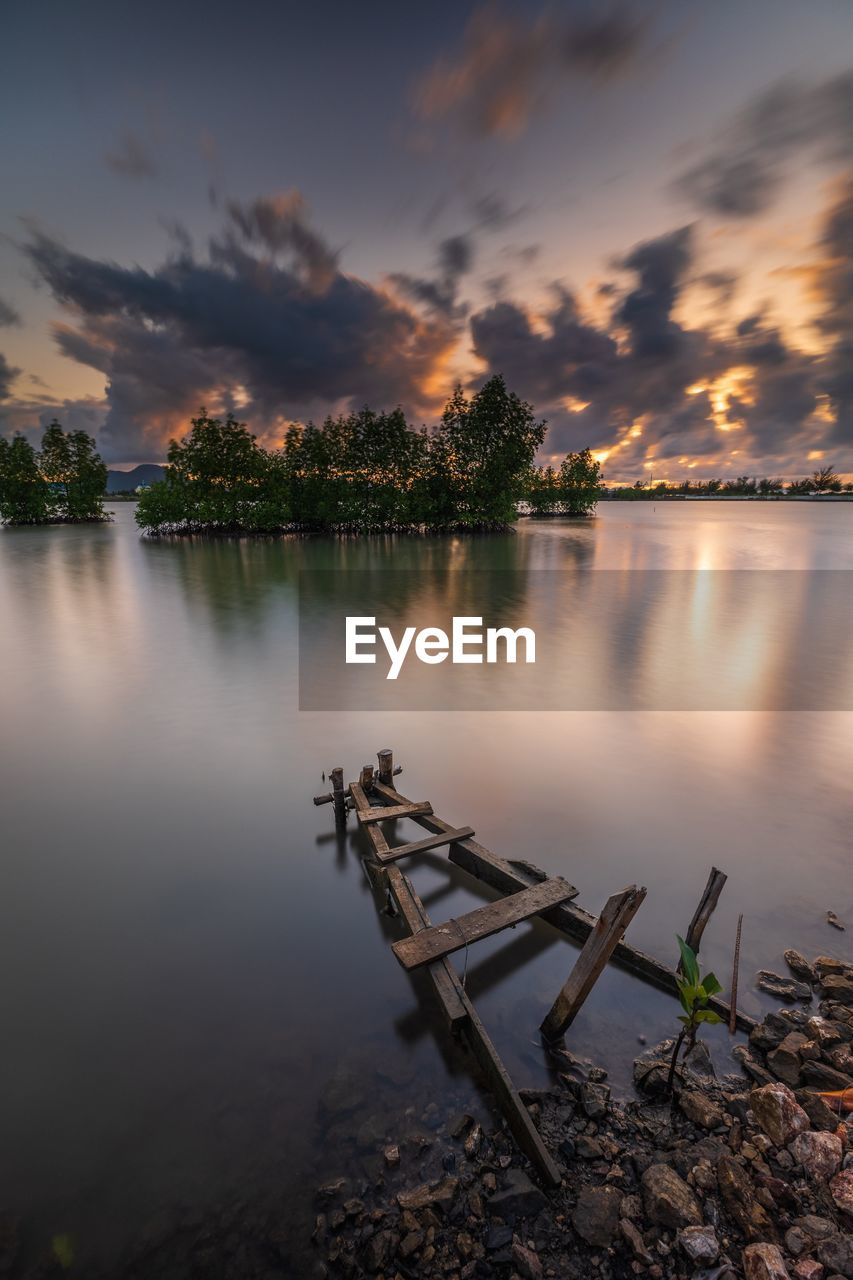 sky, water, tranquil scene, tranquility, reflection, beauty in nature, lake, scenics - nature, cloud - sky, sunset, nature, tree, no people, non-urban scene, plant, idyllic, wood - material, outdoors, land