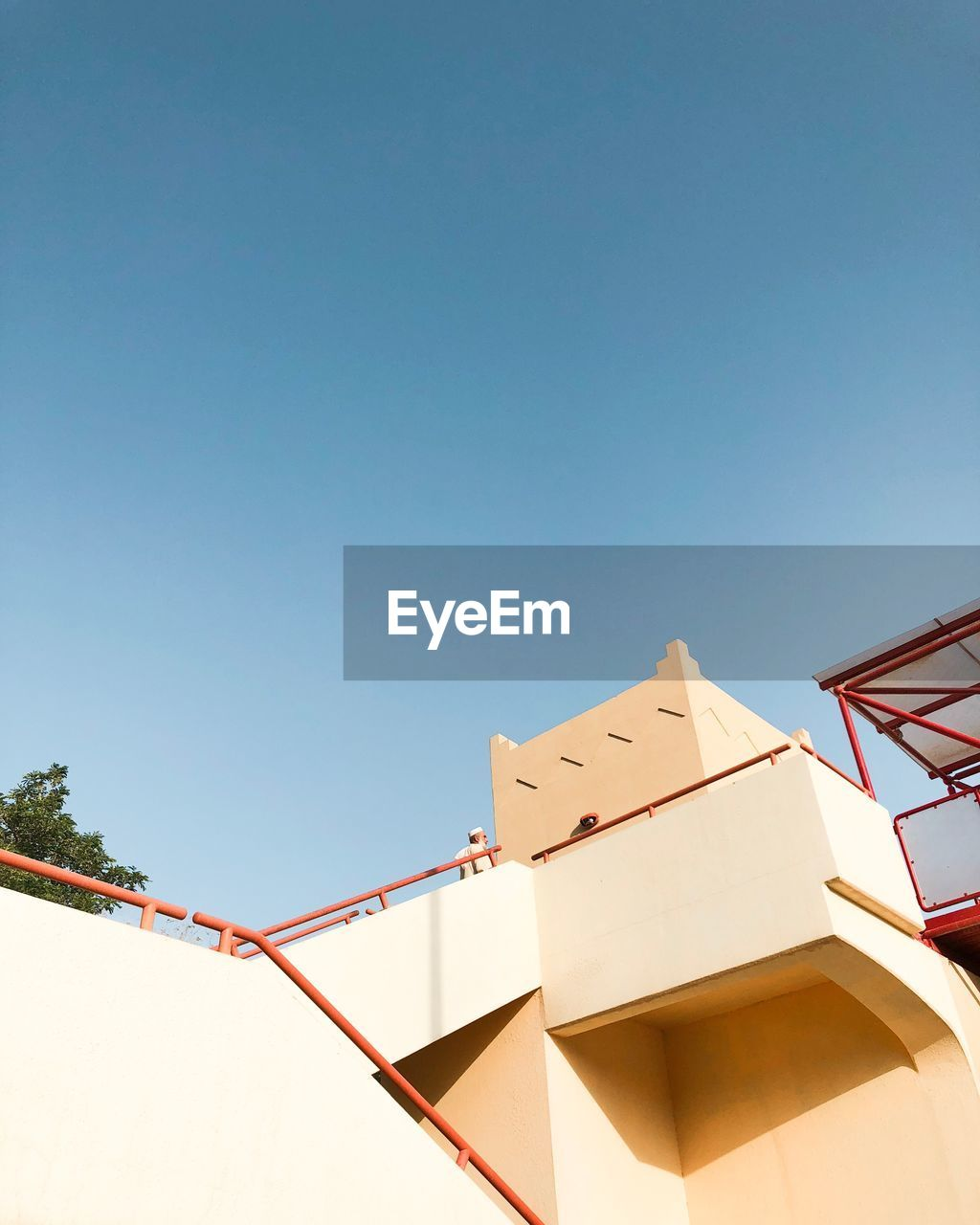 sky, low angle view, built structure, architecture, building exterior, copy space, clear sky, no people, blue, nature, day, building, sunlight, outdoors, communication, residential district, modern, city, art and craft, geometric shape
