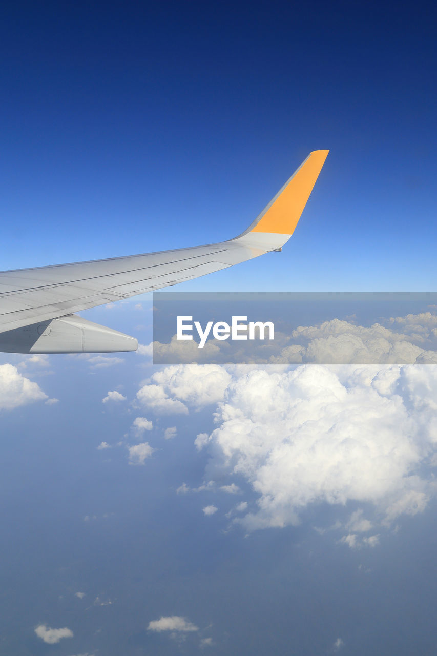 airplane, sky, air vehicle, flying, cloud - sky, mode of transportation, transportation, aircraft wing, mid-air, blue, nature, no people, travel, beauty in nature, day, motion, outdoors, on the move, public transportation, scenics - nature, aerospace industry, meteorology