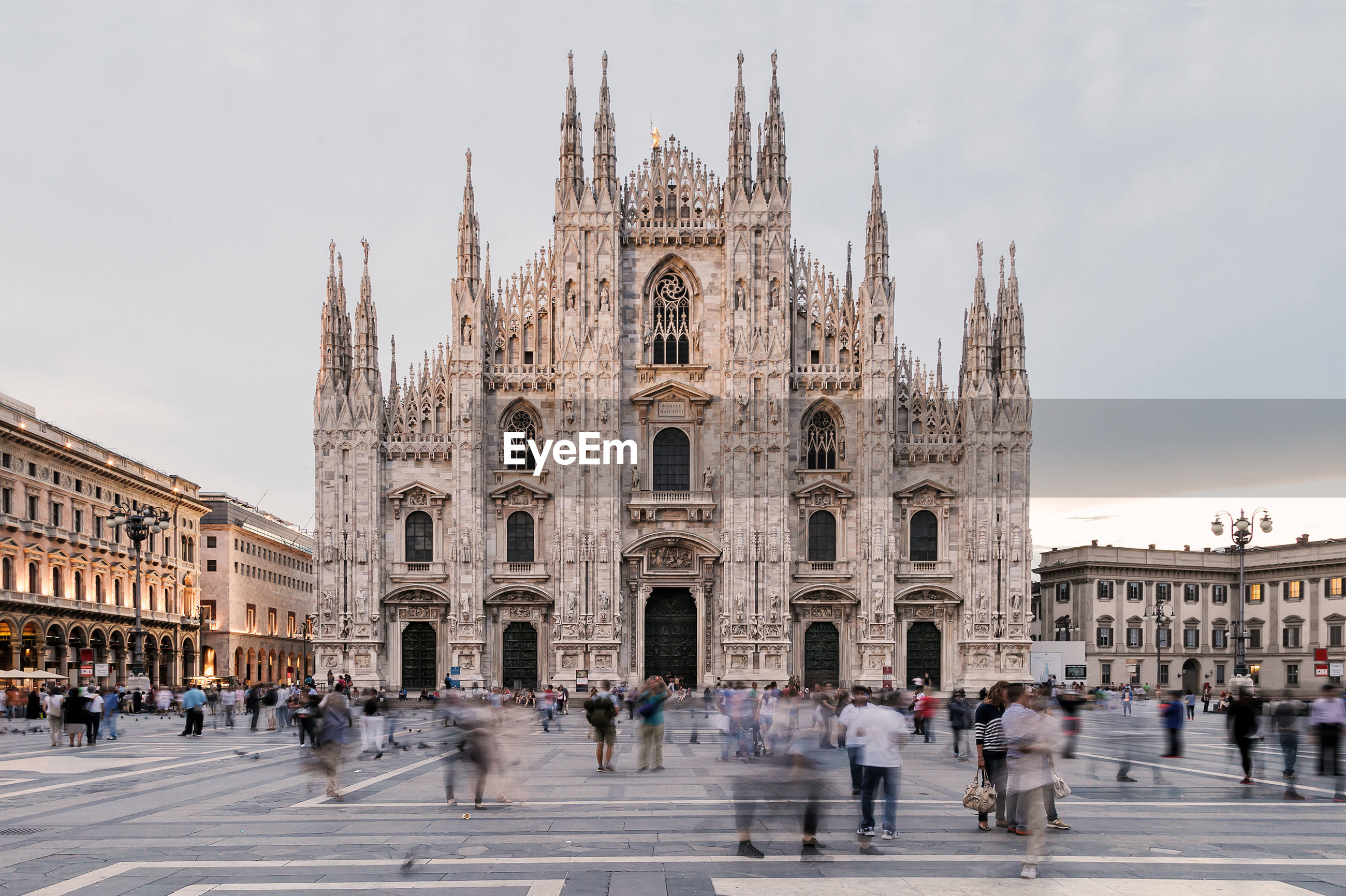 People at milan cathedral against sky