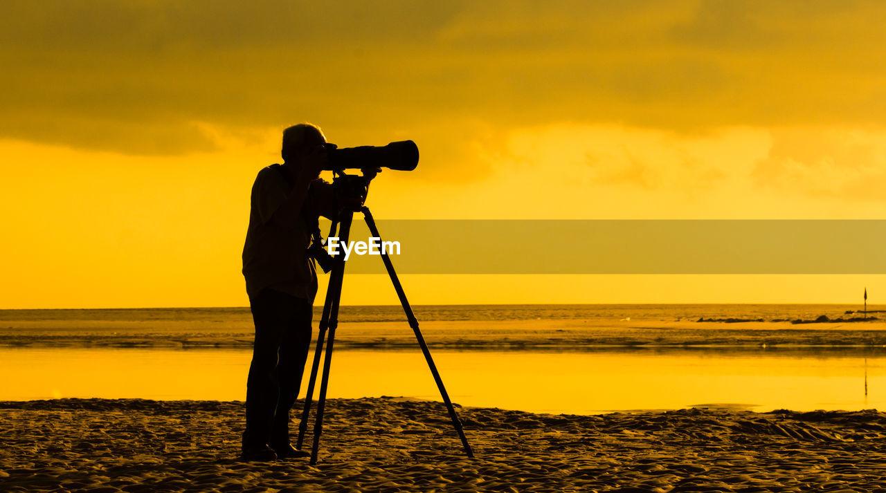 Photographer Taking Shot By Riverside