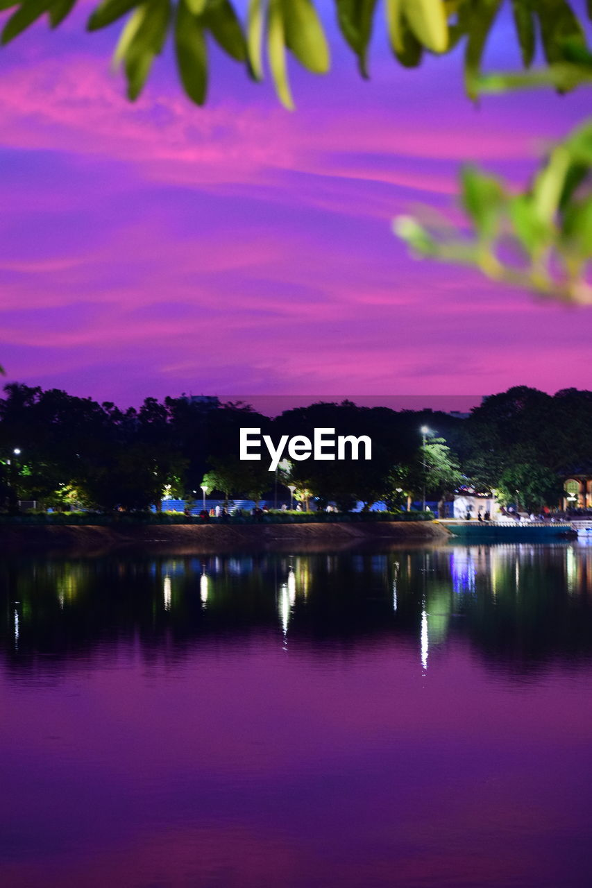 reflection, water, waterfront, illuminated, lake, sky, night, no people, cloud - sky, beauty in nature, purple, nature, plant, pink color, tree, scenics - nature, dusk, tranquility, outdoors