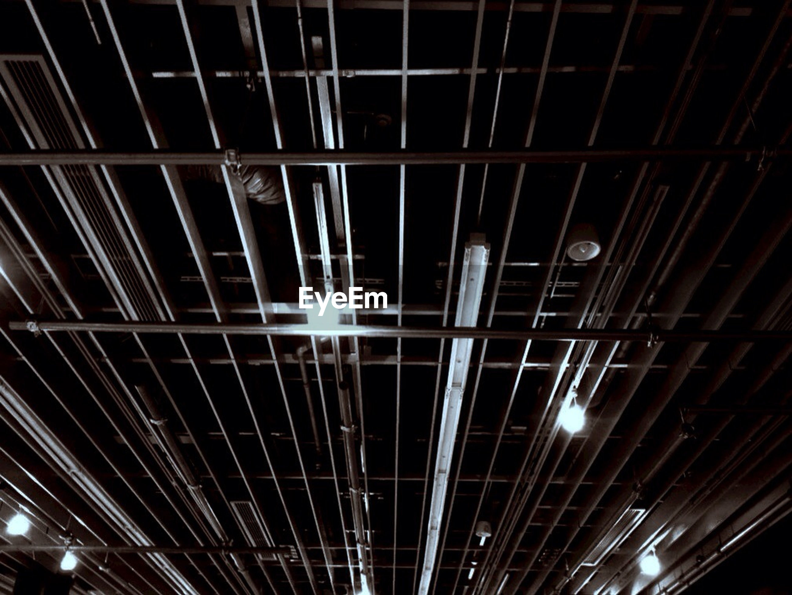 illuminated, indoors, ceiling, night, low angle view, pattern, lighting equipment, backgrounds, modern, built structure, full frame, architecture, no people, glowing, light - natural phenomenon, electric light, glass - material, electricity, repetition, technology