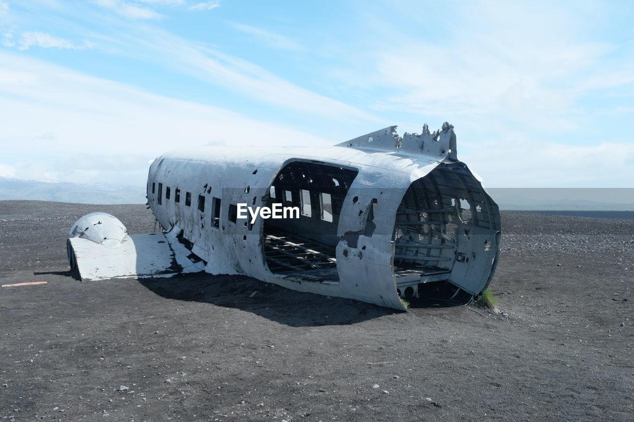 DAMAGED AIRPLANE ON BEACH