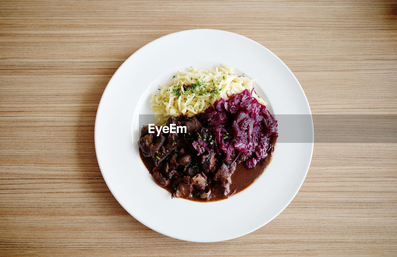 food and drink, food, table, freshness, ready-to-eat, indoors, still life, wellbeing, plate, directly above, vegetable, wood - material, healthy eating, no people, high angle view, bowl, serving size, meat, meal, rice - food staple, vegetarian food, temptation