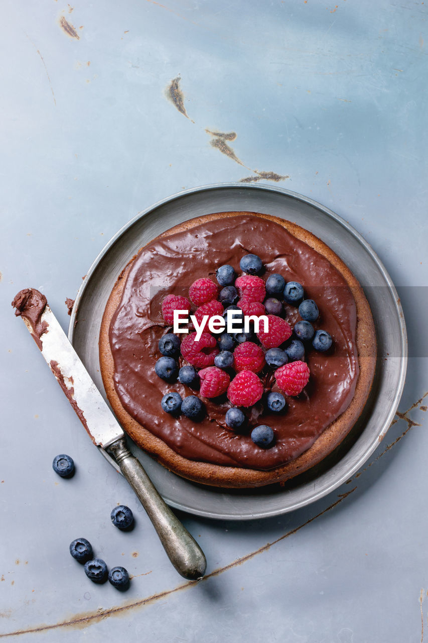 High angle view of chocolate cake served in plate at table