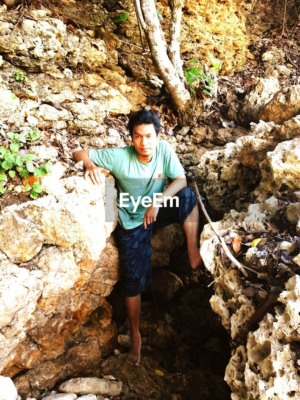 High angle portrait of man standing on rock formations