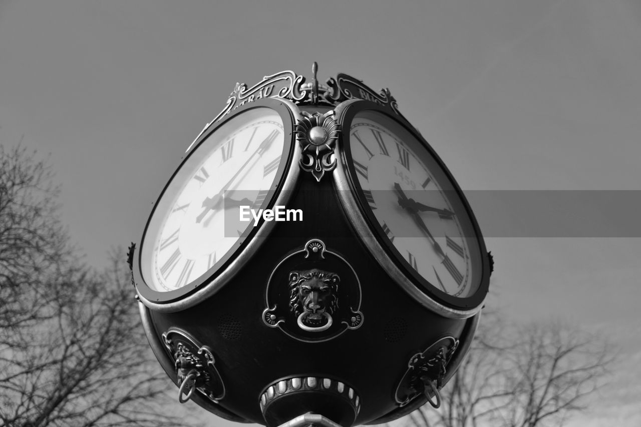 time, sky, no people, tree, day, nature, clock, focus on foreground, transportation, mode of transportation, land vehicle, retro styled, close-up, outdoors, metal, number, bare tree, low angle view, technology