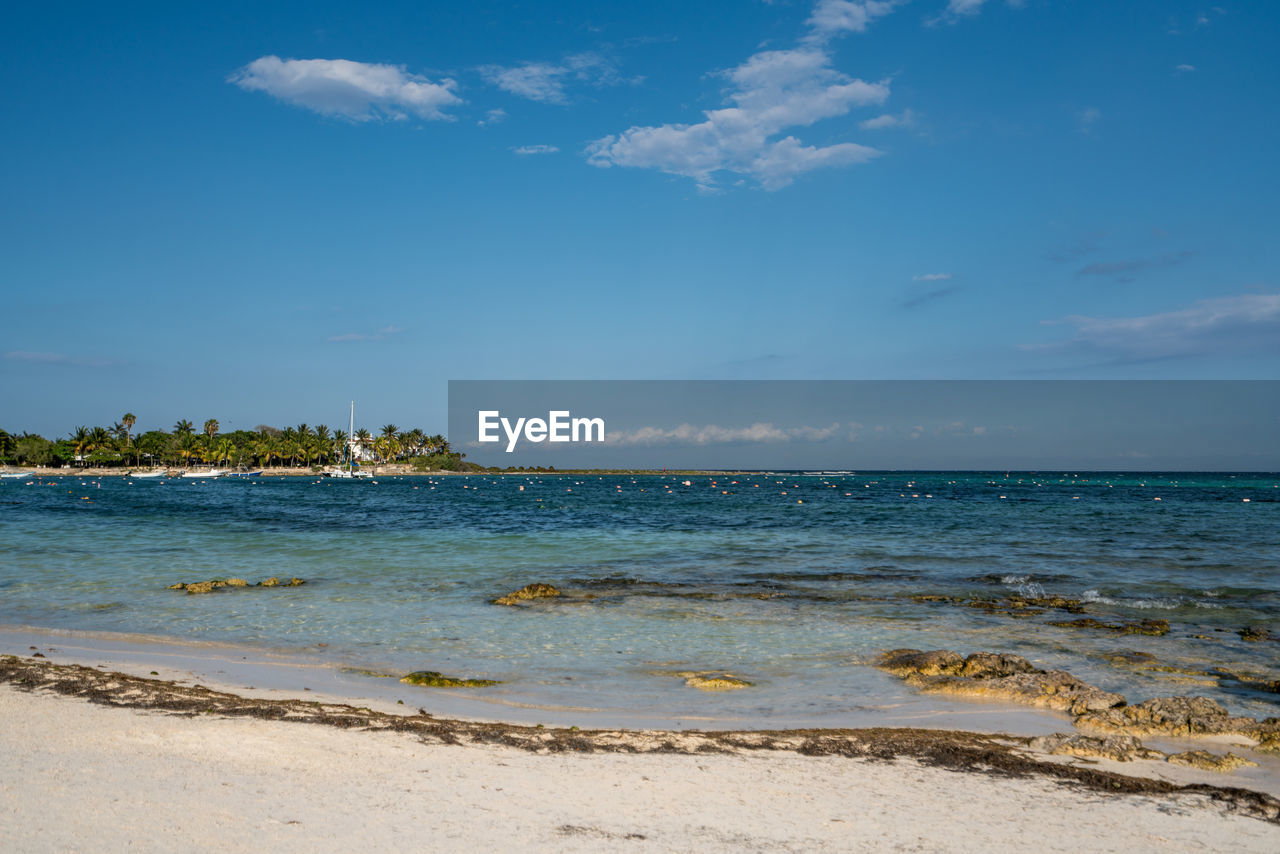 water, sky, sea, beach, land, beauty in nature, scenics - nature, tranquility, cloud - sky, tranquil scene, horizon, nature, no people, horizon over water, sand, idyllic, motion, blue, day, outdoors, turquoise colored