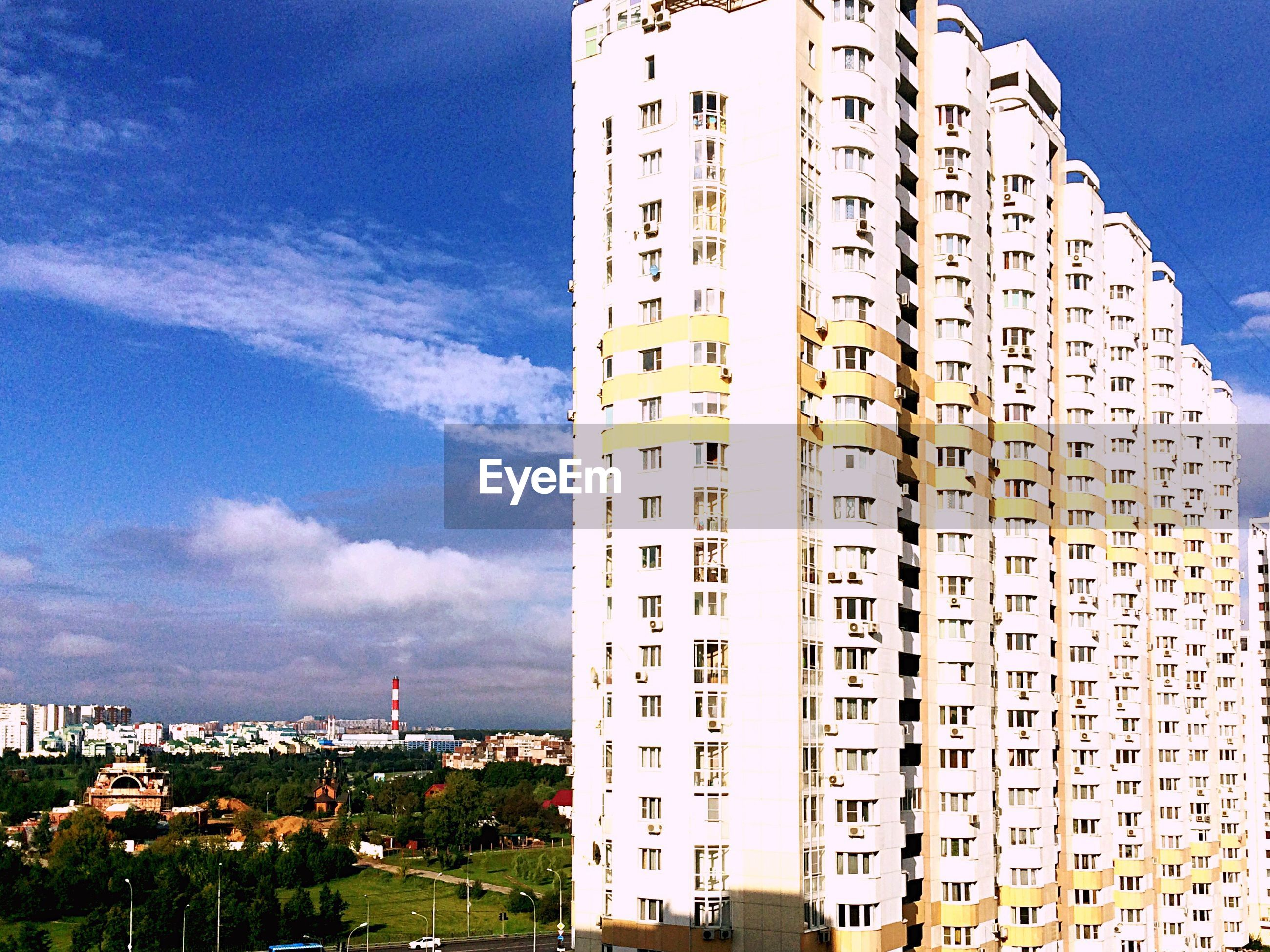 architecture, building exterior, built structure, city, sky, tall - high, skyscraper, tower, day, outdoors, apartment, cloud, office building, modern, residential district, building story, development, cloud - sky, city life, no people