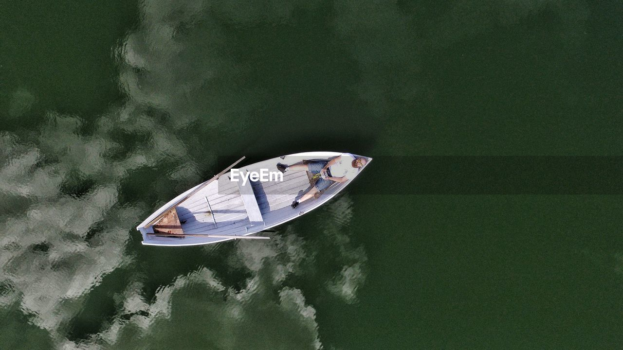 High Angle View Of Man In Boat On Sea