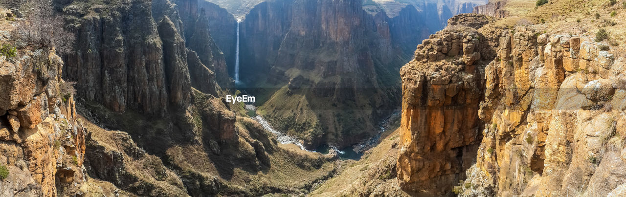 Panoramic view of rocky mountains and maletsunyane waterfall, semonkong, lesotho, africa