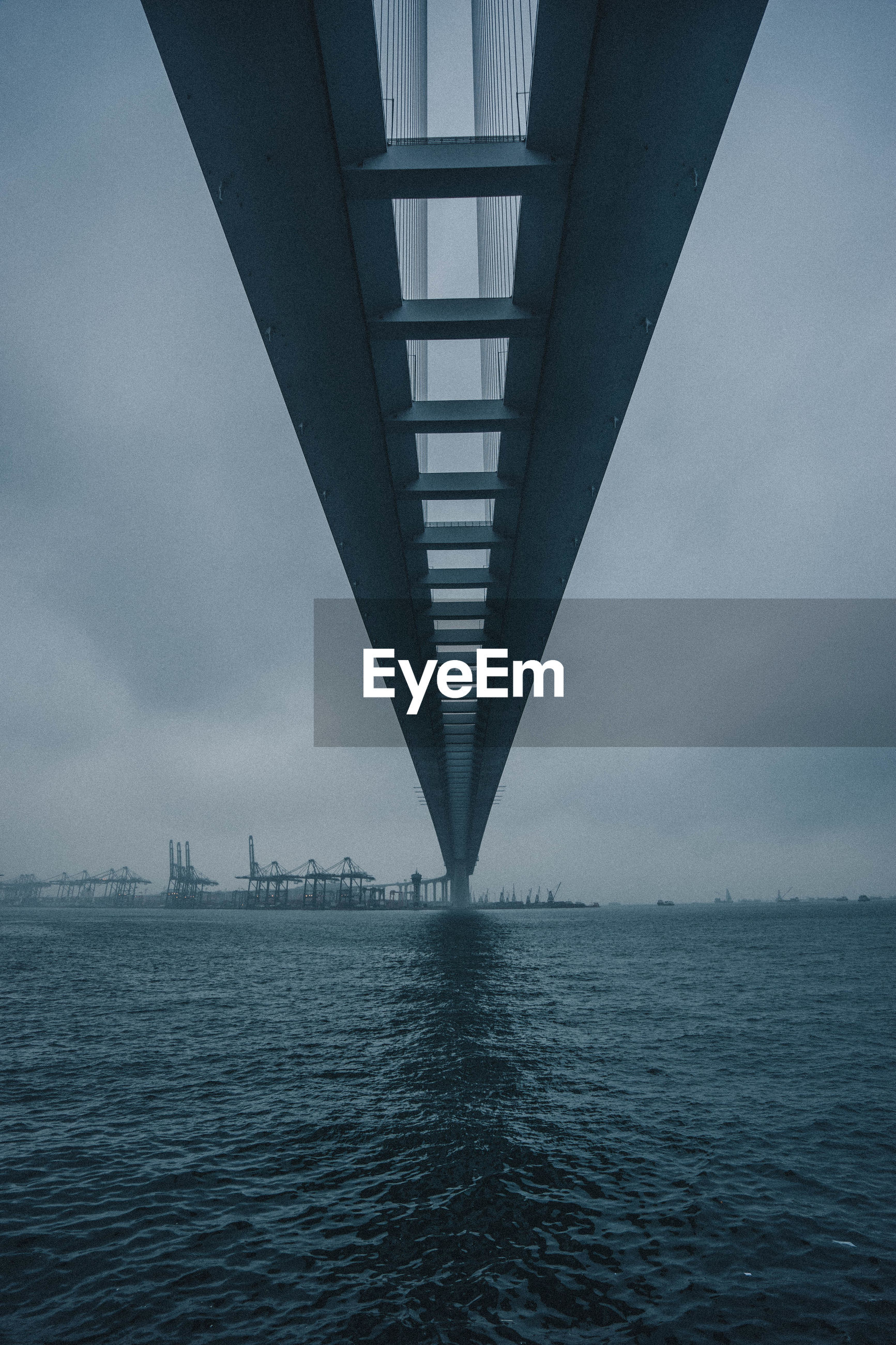 Low angle view of bridge over sea