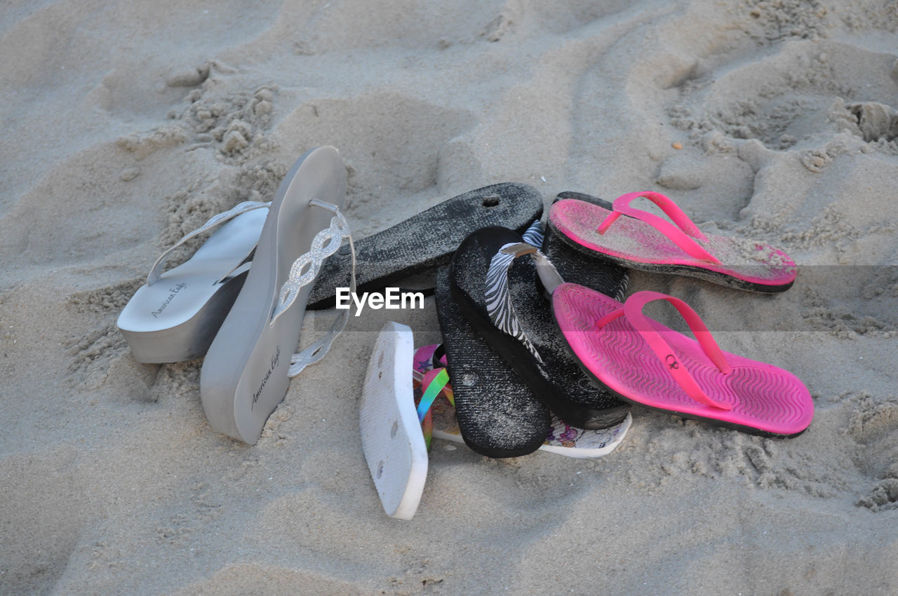 sand, beach, flip-flop, pair, shoe, high angle view, no people, absence, vacations, things that go together, day, outdoors, nature, sand pail and shovel