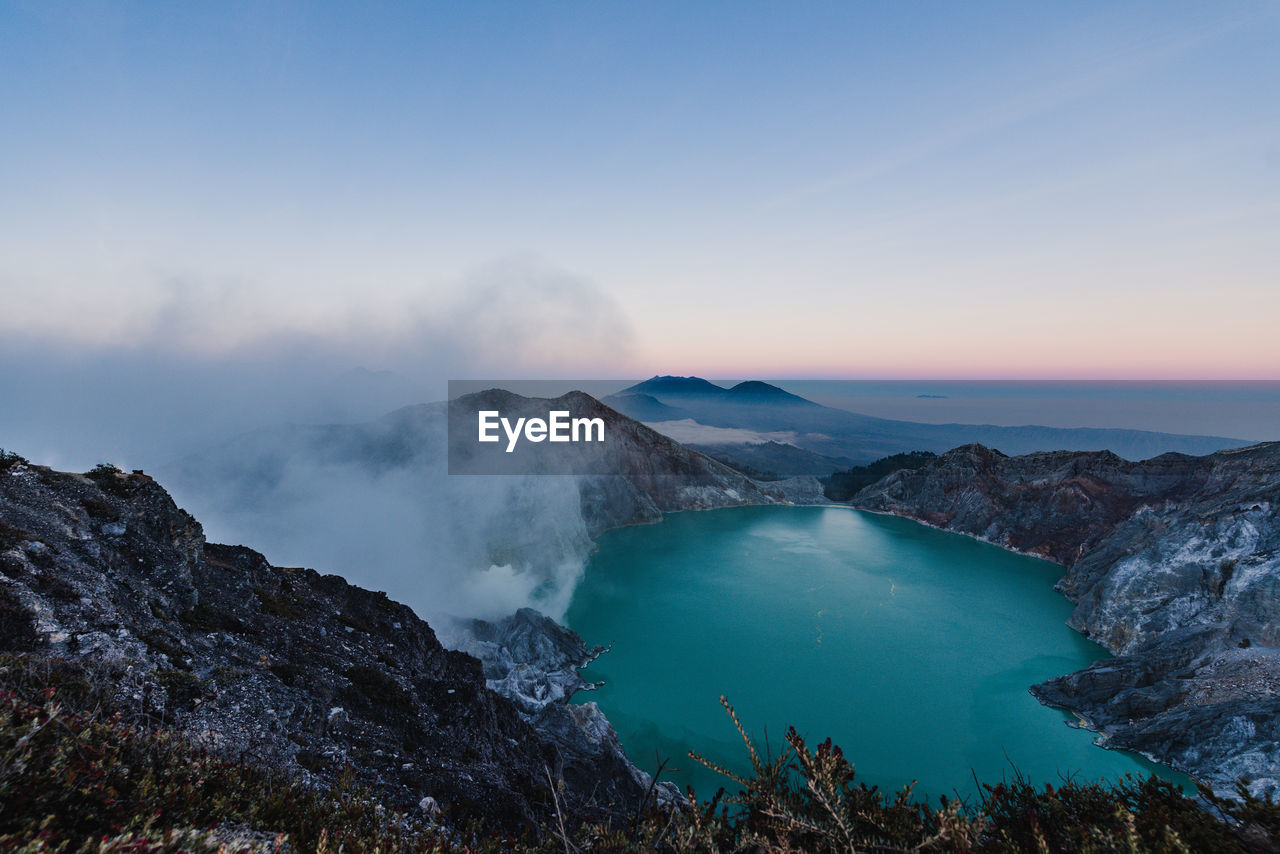 High angle view of volcanic mountain against sky