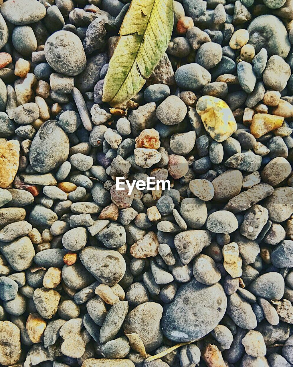 solid, stone - object, rock, stone, pebble, large group of objects, abundance, no people, day, nature, high angle view, rock - object, land, full frame, backgrounds, textured, beach, directly above, outdoors, close-up