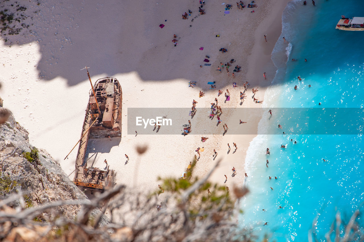 architecture, water, nature, land, high angle view, built structure, day, sunlight, beach, building exterior, sea, building, sand, no people, outdoors, vacations, trip
