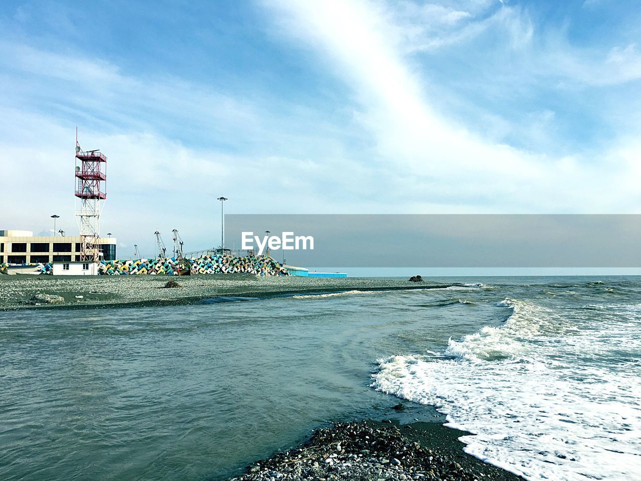 water, sea, sky, cloud - sky, built structure, architecture, day, scenics - nature, nature, waterfront, horizon, beauty in nature, building exterior, motion, horizon over water, land, no people, tower, outdoors, skyscraper