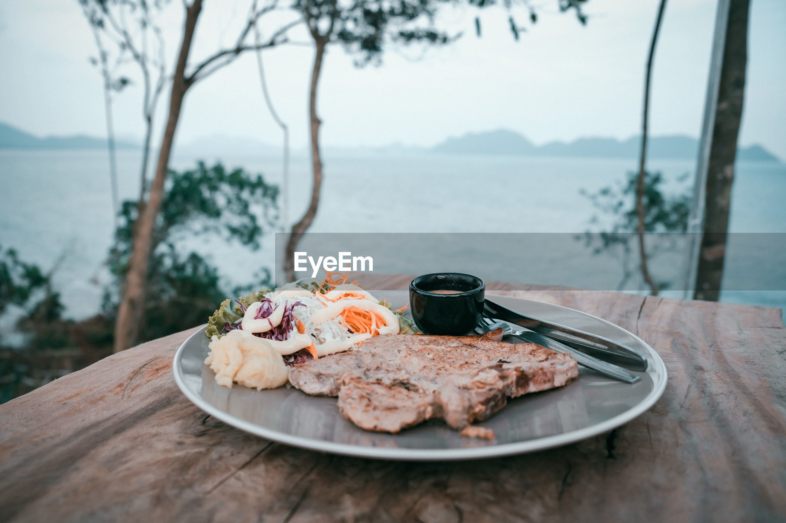 High angle view of breakfast on table in sea