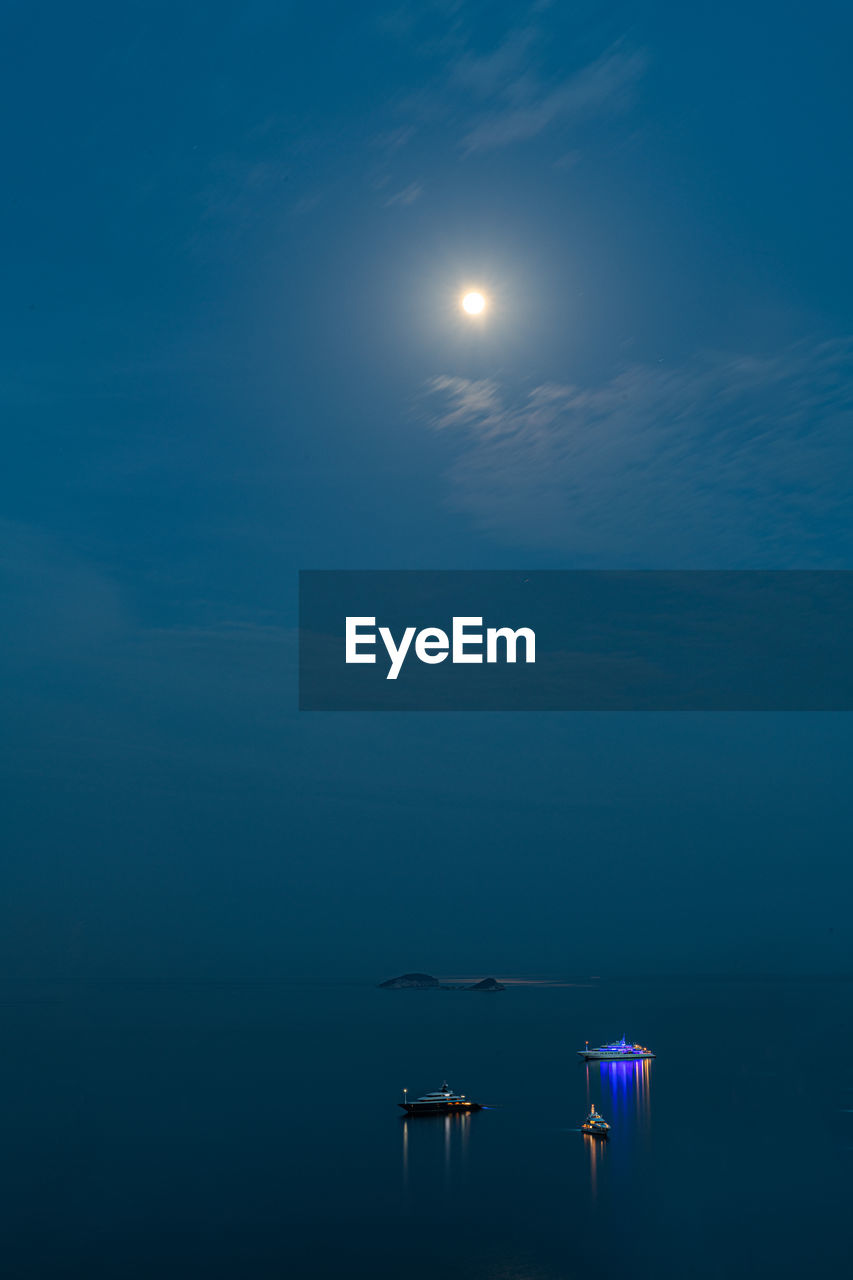 SCENIC VIEW OF SEA AGAINST MOON IN SKY
