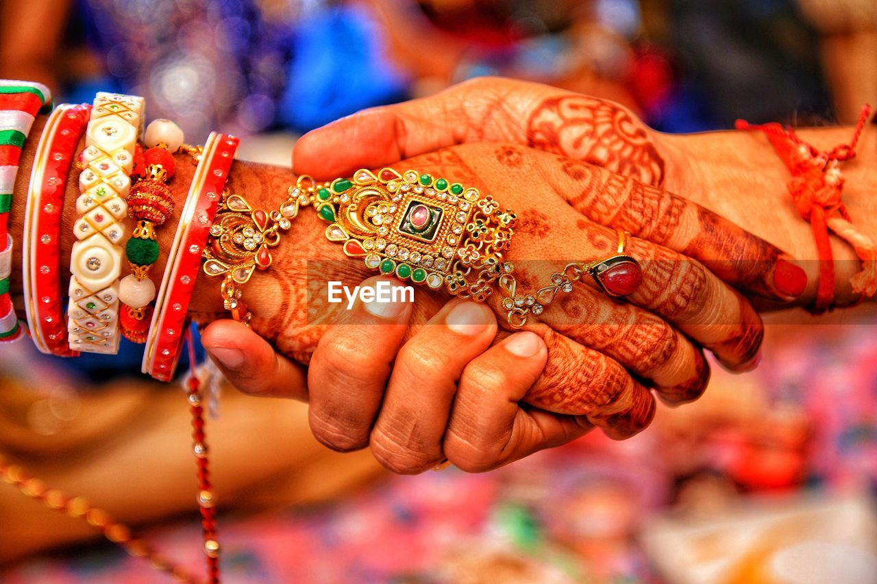 hand, human hand, focus on foreground, real people, human body part, close-up, women, celebration, midsection, holding, adult, people, incidental people, jewelry, indoors, finger, wedding ceremony